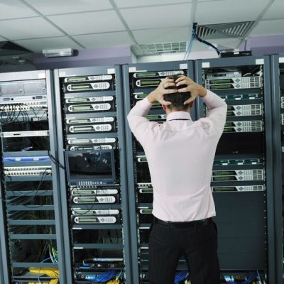 11718371 - it business man in network server room have problems and looking for  disaster situation  solution